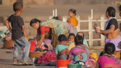 Kid watching women washing clothes at Godavari ghat,Nashik,India Stock Footage