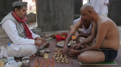 Pilgrim at ritual with hindu priest,Nashik,India Stock Footage