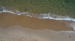 Aerial shot of the calm ocean water on a beach Stock Footage