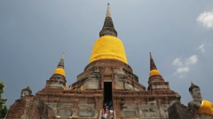 A tilt down shot of a pagoda temple in Ayutthaya Historical Park, Thailand - stock footage