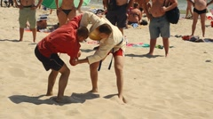 Fighting on the beach, in the presence of spectators Stock Footage