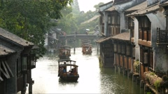 Wuzhen canal village, China canal to bridge view Stock Footage