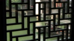 Wuzhen China canal barge thru lattice window Stock Footage