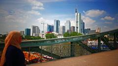4K Skyline Frankfurt am Main financial center Eisener Steg metal bridge Germany Stock Footage