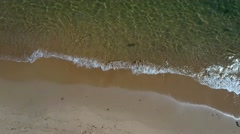 Aerial shot of the calm ocean water on beach Stock Footage