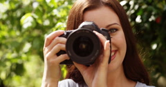 4k, Young female taking photographs from her camera. Stock Footage