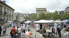 Vintage flea market in King Wiliam II square near City Hall building Stock Footage