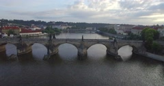 Aerial drone camera tracks sideways along the Charles bridge in Prague Stock Footage
