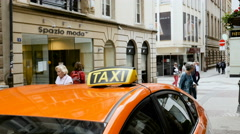 Orange taxi waiting for clients in Luxembourg center city Stock Footage