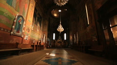 Christian church interior. Empty hall with icons and altar - stock footage