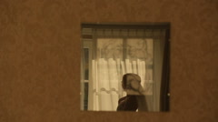 Silhouette of beautiful bride at the window - stock footage