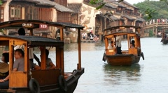 WUZHEN, CHINA wooden boats on canal with old houses Stock Footage