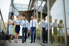 Business partners go to work together after coffee break Stock Photos