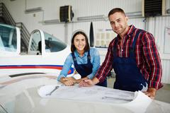 Staff of airplane repair service Stock Photos