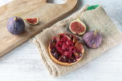 Figs and raspberries pie Stock Photos