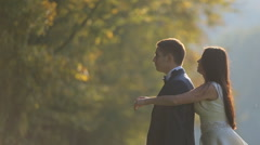 Couple in love walking at the field Stock Footage
