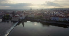 Aerial shot of sunrise behind the skyline of Prague. Arkistovideo