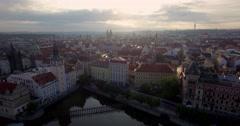 Rising aerial shot of sunrise behind the skyline of Prague. Arkistovideo