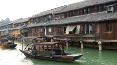 WUZHEN, CHINA canal barges & wooden houses terrace Stock Footage