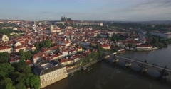 Aerial drone camera tracks sideways along the River Vltava in Prague Arkistovideo