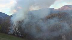 Firefighter team work to extinguish burning house toxic smoke fireman emergency Stock Footage