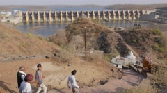 Pilgrims walk around island with dam view,Omkareshwar,India Stock Footage