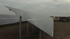 Wide shoot of row of solar panels - stock footage