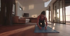 Fitness woman doing stretching exercise at home Stock Footage