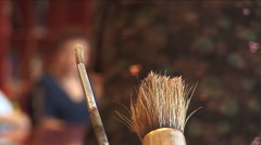 Close up on brushes in art class for senior citizens Stock Footage
