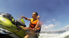Couple men on jet ski in the sea turns left Stock Footage