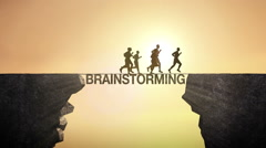 Pencil write 'Brainstorming', connecting the cliff. man crossing the cliff. Stock Footage
