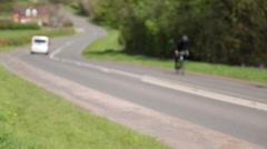 Cyclists struggling up a hill near Atherstone, Warwickshire, UK Stock Footage