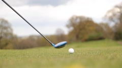 Golfer tees off at a UK golf course Stock Footage