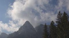 Amazing cloud pass over rocky mountain summit alpine adventure dangerous pick Stock Footage