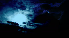 Full moon over cross time lapse Stock Footage