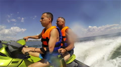 Portrait of two caucasian men riding jet ski on Azov Sea Stock Footage