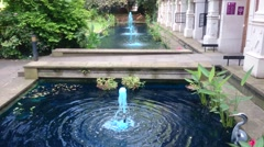 Blue water fountain in Holland park, London Stock Footage