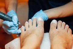 Master pedicure nails and cuticles closeup . Stock Photos