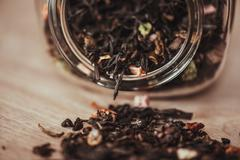 Jar with scattering of tea Stock Photos