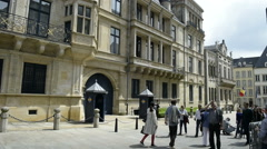Tourist and locals taking photo in front of Grand Ducal Palace, Luxembourg Stock Footage