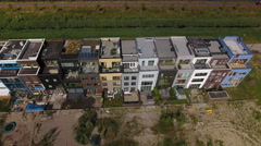 Top aerial shot of street with new, colorful houses in Amsterdam Stock Footage
