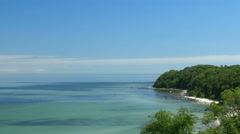 Beach view from cliff. Bay with blue sky. Rügen - Baltic Sea. Stock Footage