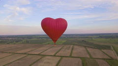 Hot air balloon in the sky over a field.Aerial view - stock footage