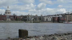 Water laps on the shore of the Thames with St Pauls Cathedral Stock Footage