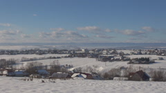 Pan right of beautiful mountain village covered by white snow in cold winter day Stock Footage
