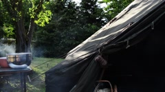 Sun Rays Through Smoke in Tranquil Camping Scene Stock Footage