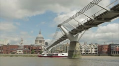 The river Thames with Ferry, St Pauls Cathedral and the Millennium Bridge Stock Footage