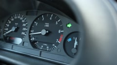 Close up view on car dashboard with blinking green arrow, turn light indicator Stock Footage