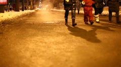 People walk at night winter road, vapour rise up from hatch, swirl in cold air Stock Footage