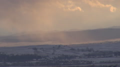 Beautiful panorama of rural village and snow storm blizzard fall mountain hill Stock Footage